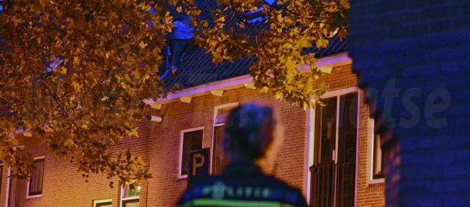 Man op dak in Leiden